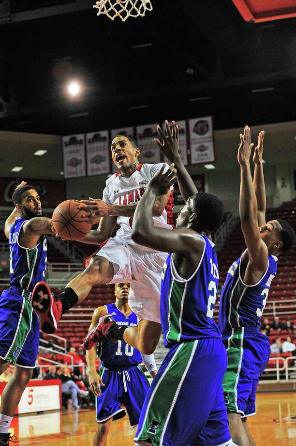 Lamar Cardinals Anthony Holliday, No. 2, center, drives the ball in Saturday against A&M-Corpus Christi Islanders at the Montagne Center. Michael Rivera/@michaelrivera88