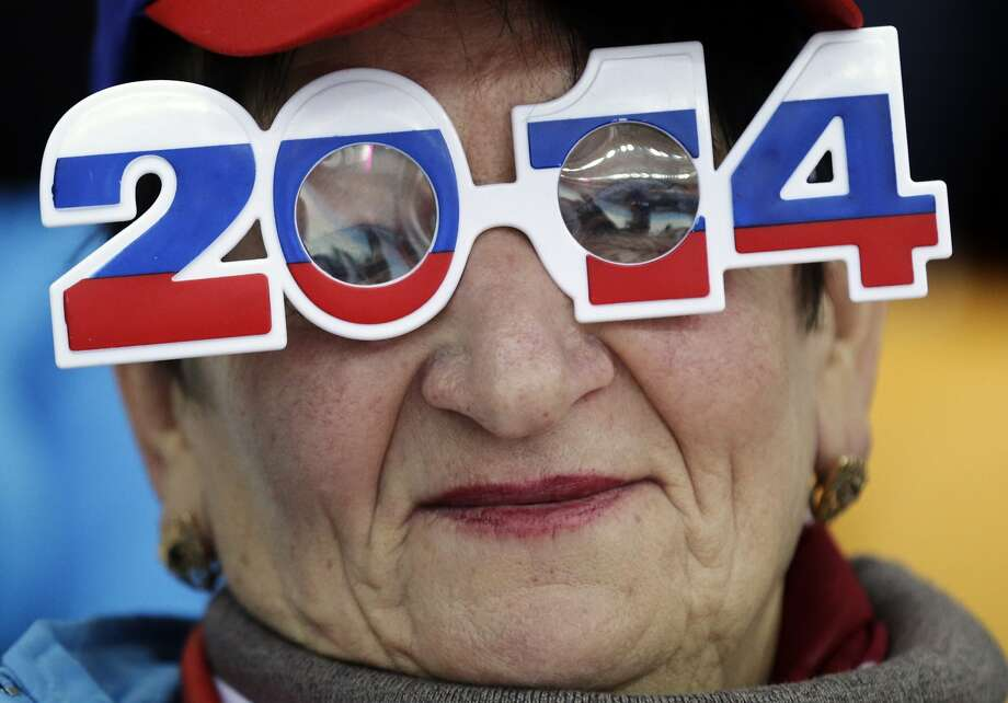 Why you should never throw out your New Year's party glasses: They can come in handy later, as this skating fan demonstrates while cheering on Russian competitors in the men's 500-meter speedskating event at Sochi. Photo: Matt Dunham, Associated Press