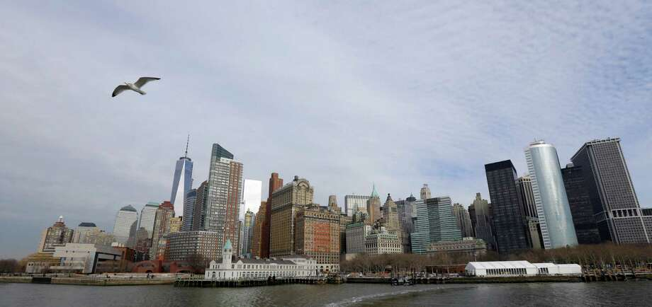 The lower Manhattan skyline, including the new One World Trade Center building, is shown as viewed from the water, Friday, Jan. 31, 2014 in New York. (AP Photo/Ted S. Warren) Photo: Ted S. Warren, Associated Press / Associated Press contributed
