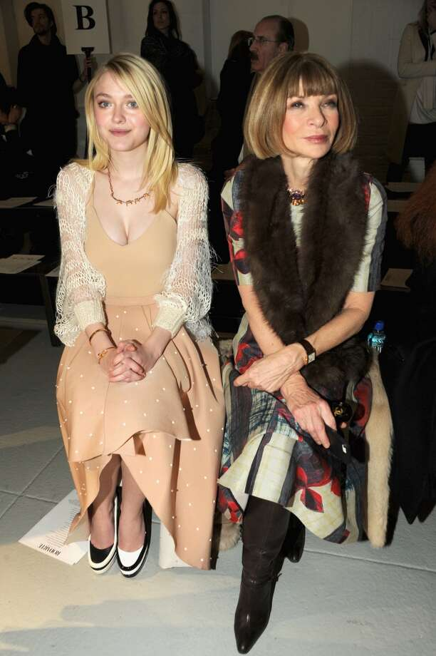 Actress Dakota Fanning (L) and Anna Wintour attend the Rodarte fashion show during Mercedes-Benz Fashion Week Fall 2014 at Center 548 on February 11, 2014 in New York City.  (Photo by Ben Gabbe/Getty Images) Photo: Ben Gabbe, Getty Images