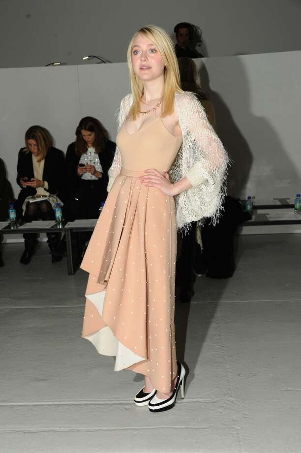 Actress Dakota Fanning attends the Rodarte fashion show during Mercedes-Benz Fashion Week Fall 2014 at Center 548 on February 11, 2014 in New York City.  (Photo by Ben Gabbe/Getty Images) Photo: Ben Gabbe, Getty Images