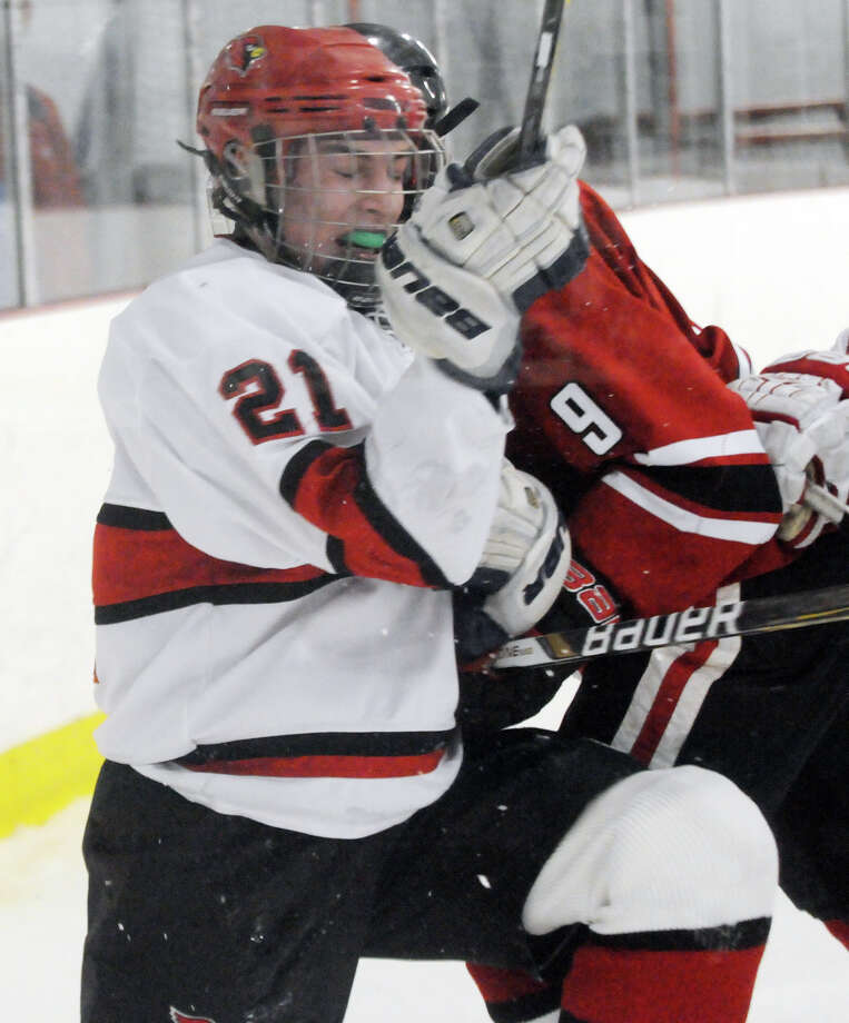 Greenwich's Ben Van Duyne and New Canaan's Peter Reinhardt collide as Greenwich hosts New Canaan High School in a boys hockey game at Dorothy Hamill Rink in Greenwich, Conn., Feb. 8, 2014. Photo: Keelin Daly / Stamford Advocate Freelance
