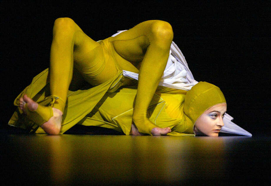 A contortionist performs in Cirque Du Soleil's Varekai.  (Associated Press) Photo: PAUL CHIASSON, AP / CP