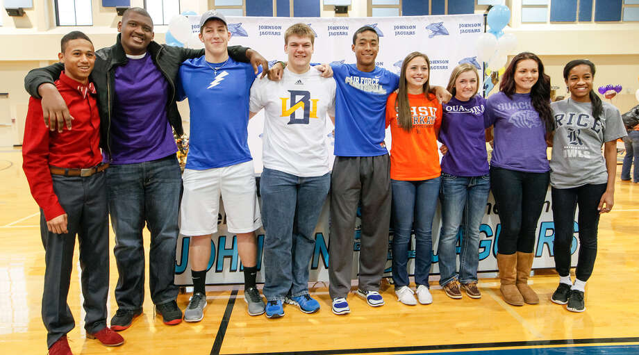 Johnson's (from left) Robert Ford (track-USC), Robert Ballard (football-Stephen F. Austin), J.C. Rast (football-Air Force Academy), Jeremiah McCutcheon (football-Wayland Baptist), Darion McElhannon (football-Air Force Academy), Caitlin Schwarz (soccer-Sam Houston State), Sarah Fish (soccer-Ouchita Baptist), Tiana Soulas (soccer-Ouchita Baptist) and Nia Stallings (soccer-Rice) signed their national letters of commitment in the Johnson High School gym on Feb. 5's National Signing Day. Photo: Marvin Pfeiffer / Stone Oak Weekly / EN Communities 2014
