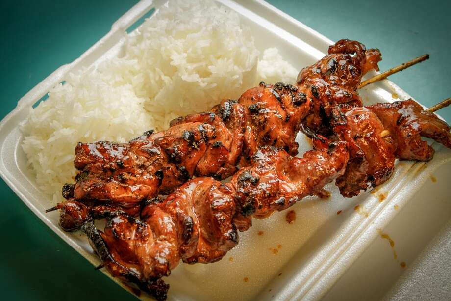 A BBQ Chicken skewer with rice at Fil-Am Cuisine in Daly City. Photo: John Storey, Special To The Chronicle