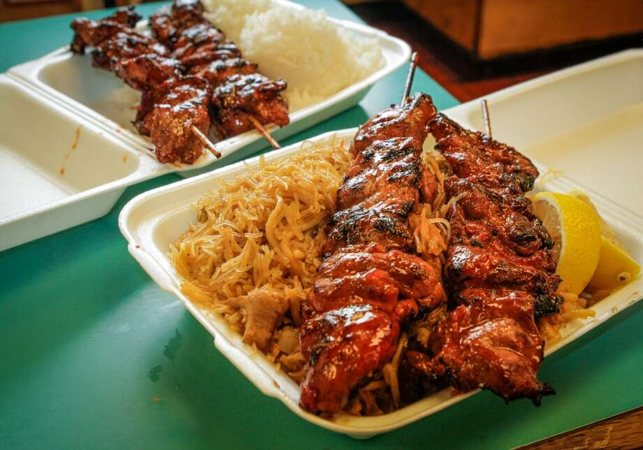 A BBQ Pork skewer with noodles and a Chicken skewer with rice at Fil-Am Cuisine in Daly City. Photo: John Storey, Special To The Chronicle