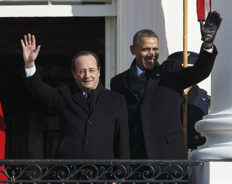 President Obama (right) hosts a state visit by French President Francois Hollande. Photo: J. Scott Applewhite, Associated Press