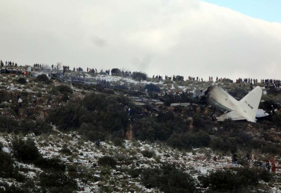 People look at the wreckage of an Algerian C-130 Hercules military transport plane after it crashed into a mountain in the nation's rugged eastern region. One person survived. Photo: Mohamed Ali, Associated Press