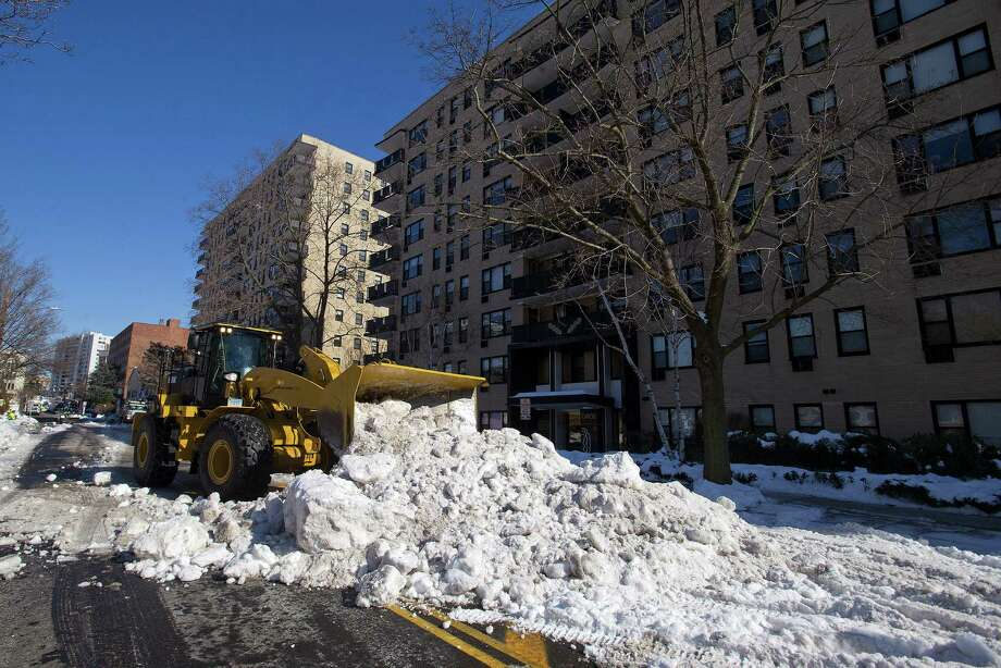 City employees remove and relocate snow from Prospect Street and other downtown roads in advance of an oncoming snowstorm on Tuesday, February 11, 2014. Photo: Lindsay Perry / Stamford Advocate