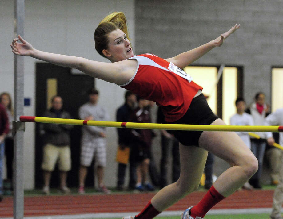 Fairfield Warde's Jackie Seymour competes in the high jump, during Class L Championship track action at Hillhouse High School's Floyd Little Athletic Center in New Haven, Conn. on Thursday February 6, 2014. Photo: Christian Abraham / Connecticut Post