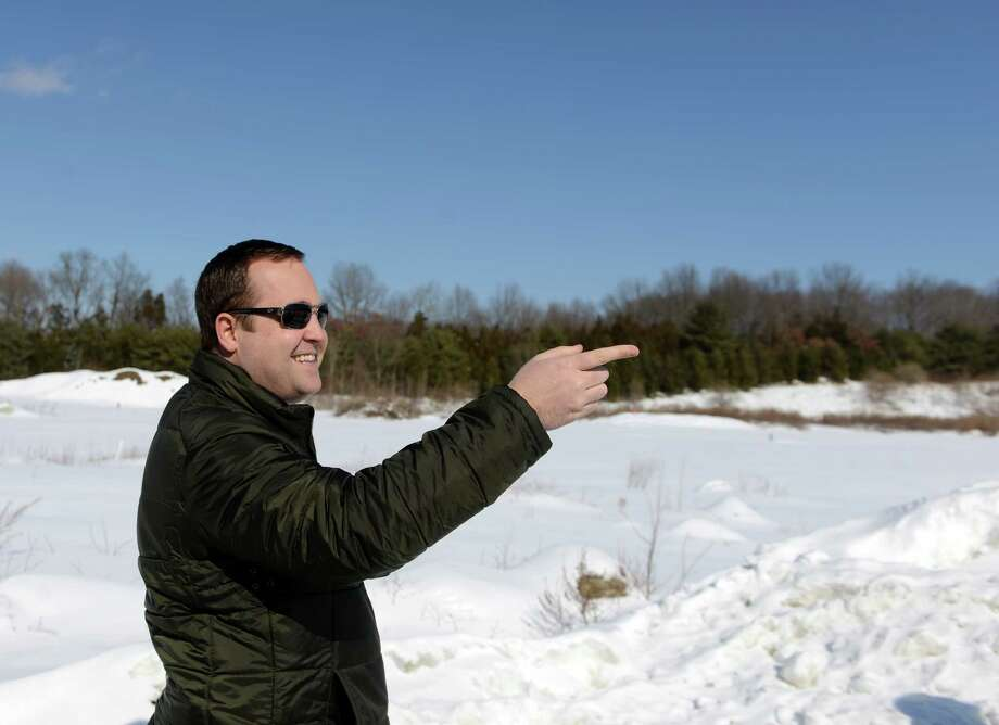 Kevin Solli, whose engineering firm designed the project, talks about plans for a 161,000-square-foot retail project near Swiss Army corporate headquarters in Monroe. Photo: Autumn Driscoll / Connecticut Post