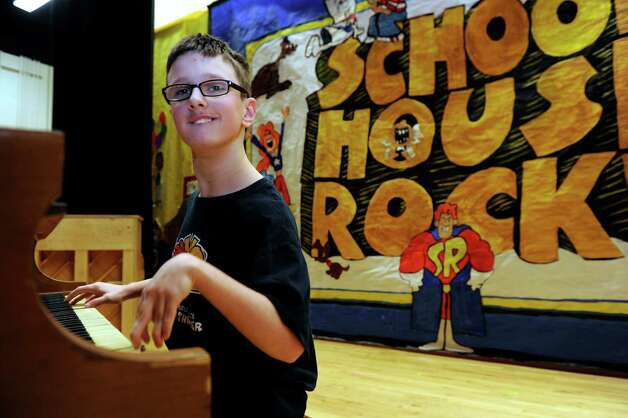"Chance Taylor, 14, an eighth-grader at Broadview Middle School in Danbury, Conn., plays the piano in the school play, ""School House Rock Jr."" Photo: Carol Kaliff / The News-Times"
