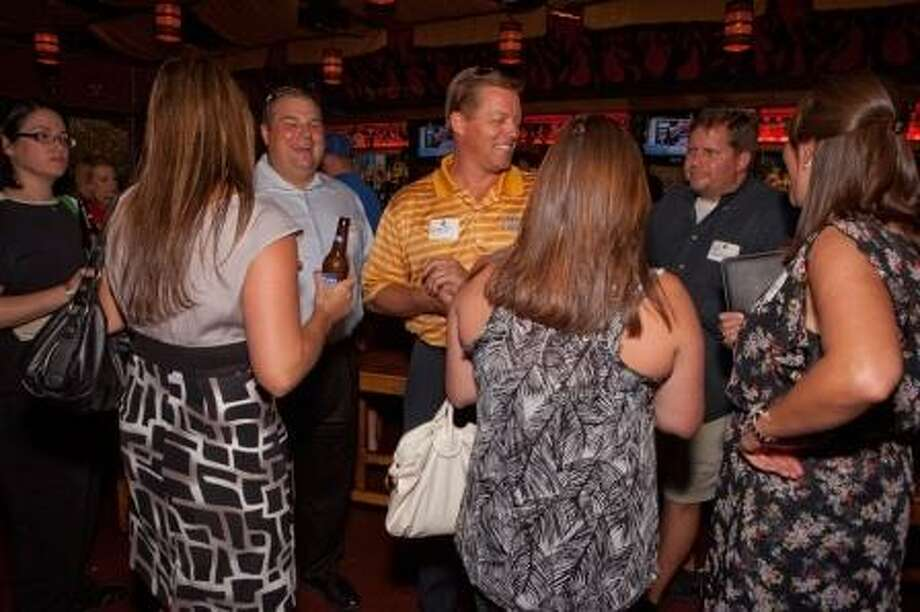Guests enjoy networking during a recent Business After Hours meeting. Photo: Provided By Greater Heights Area Chamber Of Commerce