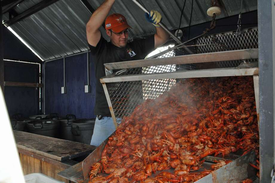 A primary attraction at the annual Heights Crawfish Festival on March 8, of course, will be piles of steamed crawfish with potatoes and corn. Jerry Garrett of PJ s Cajun Cookers prepares crawfish at a previous Heights Crawfish Festival. Photo: Heights Chamber Of Commerce / Heights Chamber of Commerce