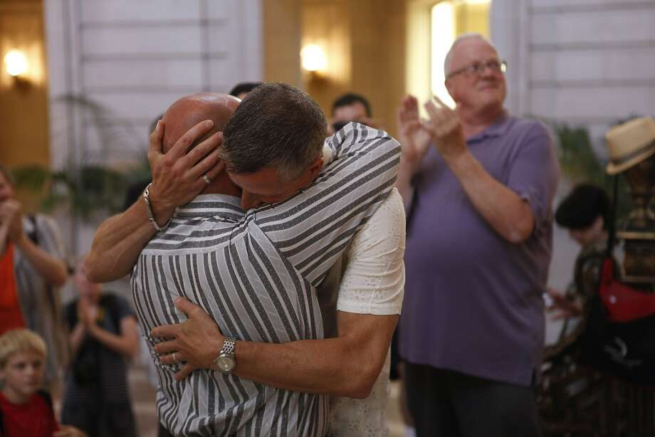 Joe Thompson and Les Leventhal embrace after being pronounced spouses at S.F. City Hall on June 29, three days after the Supreme Court's ruling. Photo: Katie Meek, The Chronicle