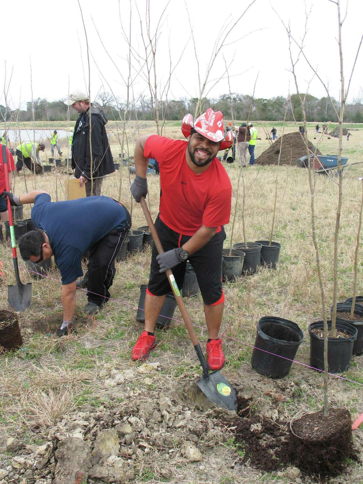 A volunteer digs at the Houston Area Urban Forestry Council's 2014 Arbor Day Tree Planting Competition held on Feb. 1 at a detention basin.