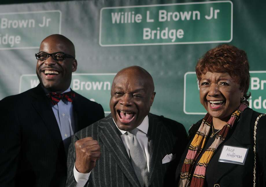 Willie Brown stands between state Assemblyman Isadore Hall, from Compton, and Alice Huffman, president of the California chapter of the NAACP, at a ceremony on Treasure Island to dedicate the renaming of the western Bay Bridge span after Willie Brown in San Francisco, Calif. on Tuesday, Feb. 11, 2014. Hall introduced the legislation to rename the bridge at the suggestion of Huffman. Photo: Paul Chinn, The Chronicle