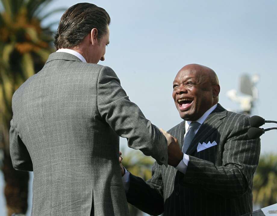 Ex-Mayor Willie Brown (right), with Lt. Gov. Gavin Newsom, is lobbying City Hall on behalf of high-rise developers who are contesting assessments. Photo: Paul Chinn, The Chronicle
