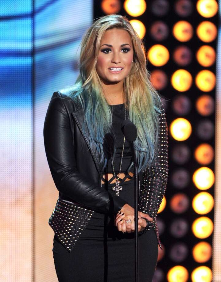 Demi Lovato speaks during the 2012 Teen Choice Awards.  (Photo by Kevin Winter/Getty Images) Photo: Kevin Winter, Getty Images