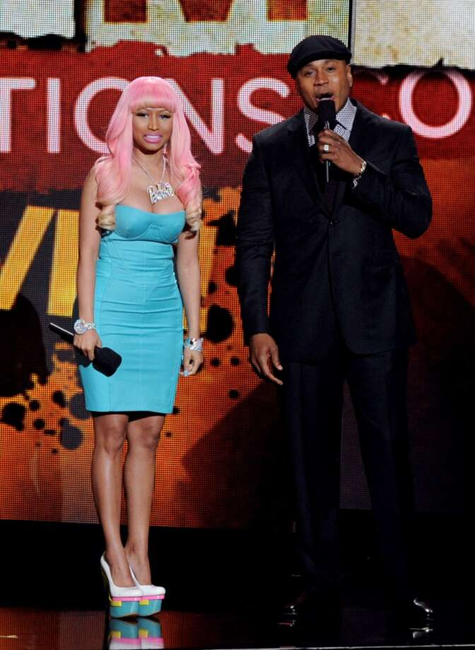 Nicki Minaj (L) and LL Cool J appear at the GRAMMY Nominations Concert Live at the Nokia Theater on November 30, 2011 in Los Angeles.  (Photo by Kevin Winter/Getty Images) Photo: Kevin Winter, Getty Images