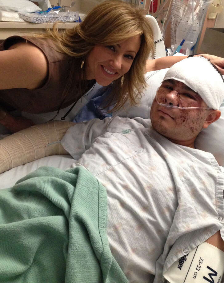 Delaine Mathieu visits Paul Hernandez during his recovery. Photo: Courtesy Delaine Mathieu / San Antonio Express-News