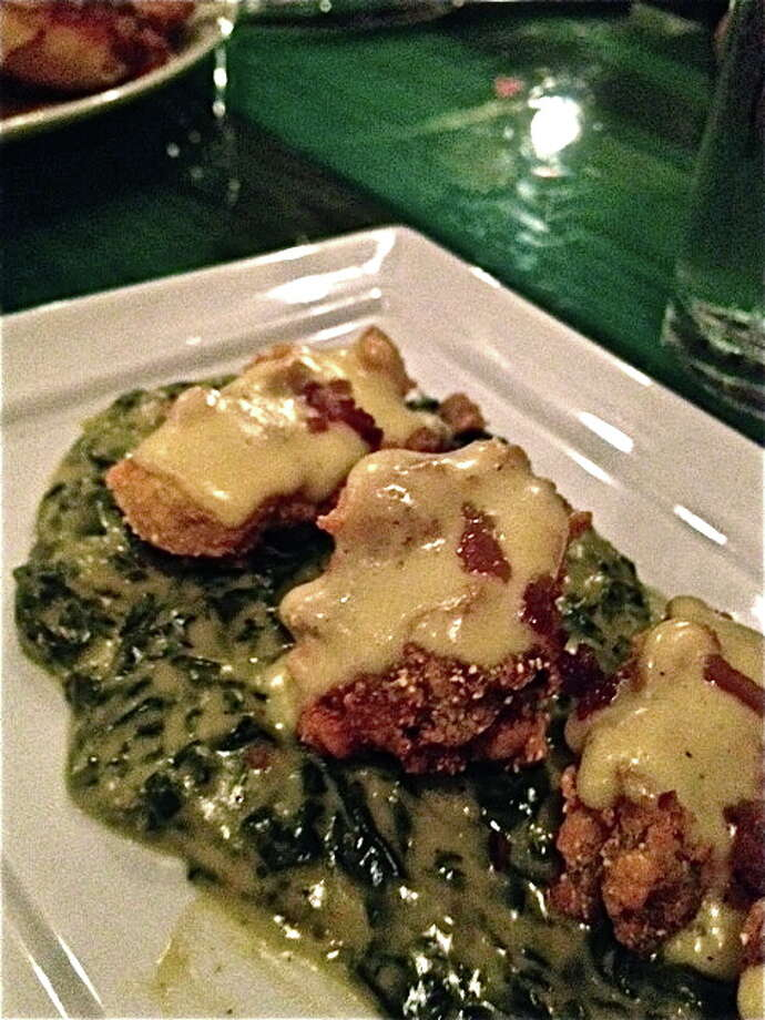 Fried oysters Rockefeller with bacon Hollandaise at Heights General Store. Photo: Alison Cook