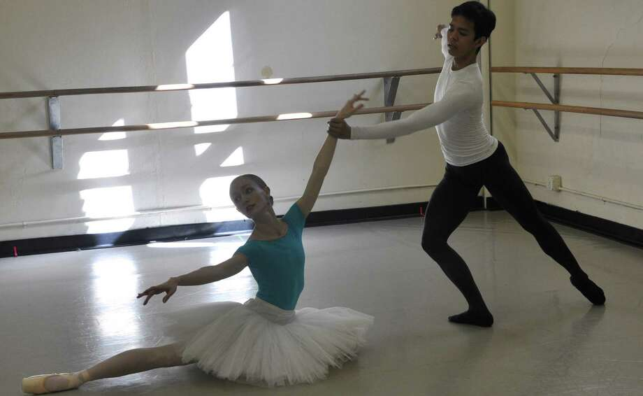 "Ballet San Antonio dancers Sarah Pautz and Jayson Pescasio rehearse ""The Firebird,"" which was upgraded for the company by Phillip Otto of the Huntsville Ballet. Photo: Courtesy Ballet San Antonio"