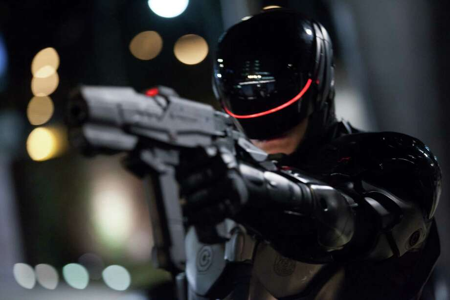 "This image released by Columbia Pictures shows Joel Kinnaman in a scene from ""RoboCop."" (AP Photo/Columbia Pictures - Sony, Kerry Hayes) Photo: Kerry Hayes, HOEP / Columbia Pictures Sony"