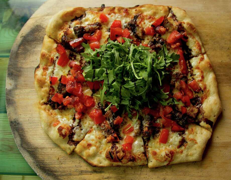 The PBLT flatbread (pork belly, arugula, diced tomatoes, olive oil, and balsamic glaze) at the Heights General Store,Friday, Feb. 7, 2014.  ( Karen Warren / Houston Chronicle ) Photo: Karen Warren, Staff / © 2013 Houston Chronicle