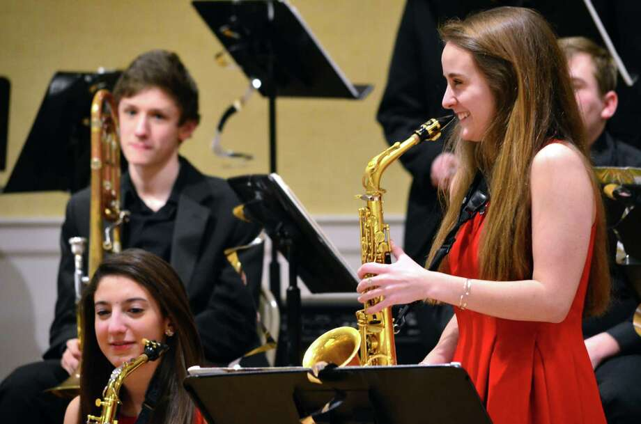 Rebecca DeMaio, playing the alto saxophone, was a featured during one jazz piece at an Evening of Sweet Jazz on Feb. 6. Throughout the evening, several musicians soloed at the Darien Community Association. The money raised is donated to the Darien music department. Photo: Megan Spicer / Darien News
