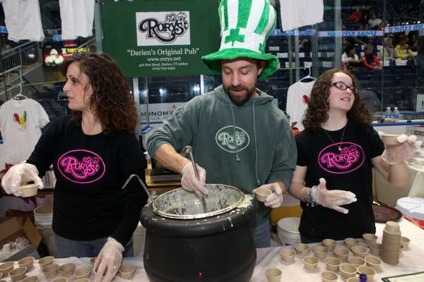Laura Stansfield, left, Bryn Malcarney, and Ellen Stansfield, 13, serve soup from Rory's in Darien at the sixth annual Chowdafest  at the Webster Bank Arena in Bridgeport, Conn. on Sunday, Feb. 2, 2014. Rory's is participating in Darien, Conn., Restaurant Week that goes through Feb. 13, 2014. Visit rorys.net