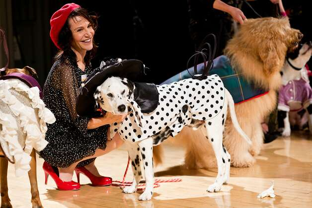 The Dalmation known as Ernest Borgniner, 13, a Muttville adoptee, wears an outfit by Madaline Pacheco with her owner,  Muttville founder Sherri Franklin, during the Haute Dog Competition benefitting Muttville at the SF Design Center in San Francisco, Calif., Friday February 7, 2014. Photo: Jason Henry, Special To The Chronicle