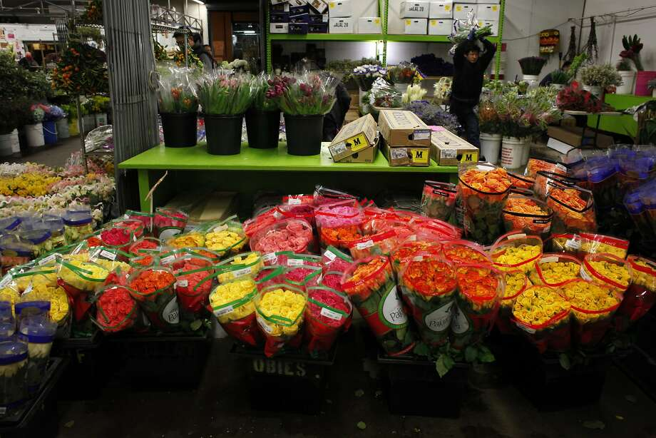 As Feb. 14 approaches, the S.F. Flower Mart is awash in roses of various hues, but especially red roses, which most commonly hail from Ecuador and Colombia. As for the price - expect to pay double for every stem. Photo: Lacy Atkins, The Chronicle