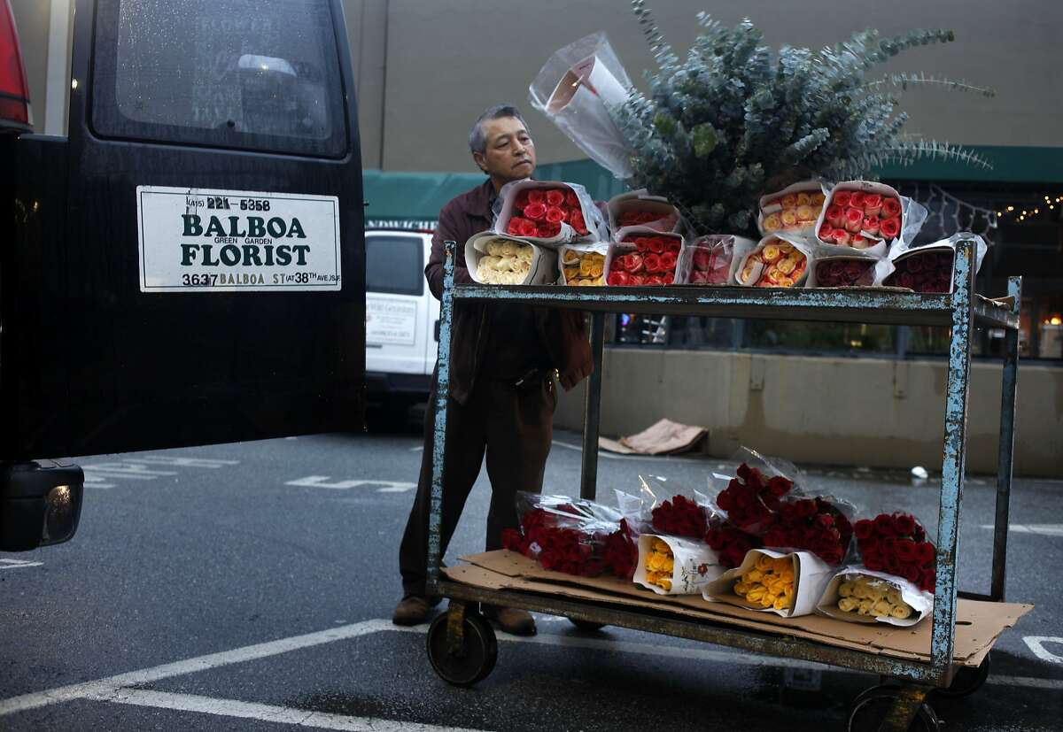 Kwang Kim of Balboa Green Garden Florist loads his order into his van after shopping at the San Francisco Flower Mart, Monday, February 10, 2014, in San Francisco, Calif.