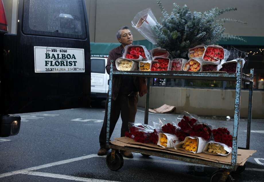 Kwang Kim of Balboa Green Garden Florist  loads his order into his van after shopping at the San Francisco Flower Mart,  Monday, February 10, 2014, in San Francisco, Calif. Photo: Lacy Atkins, The Chronicle