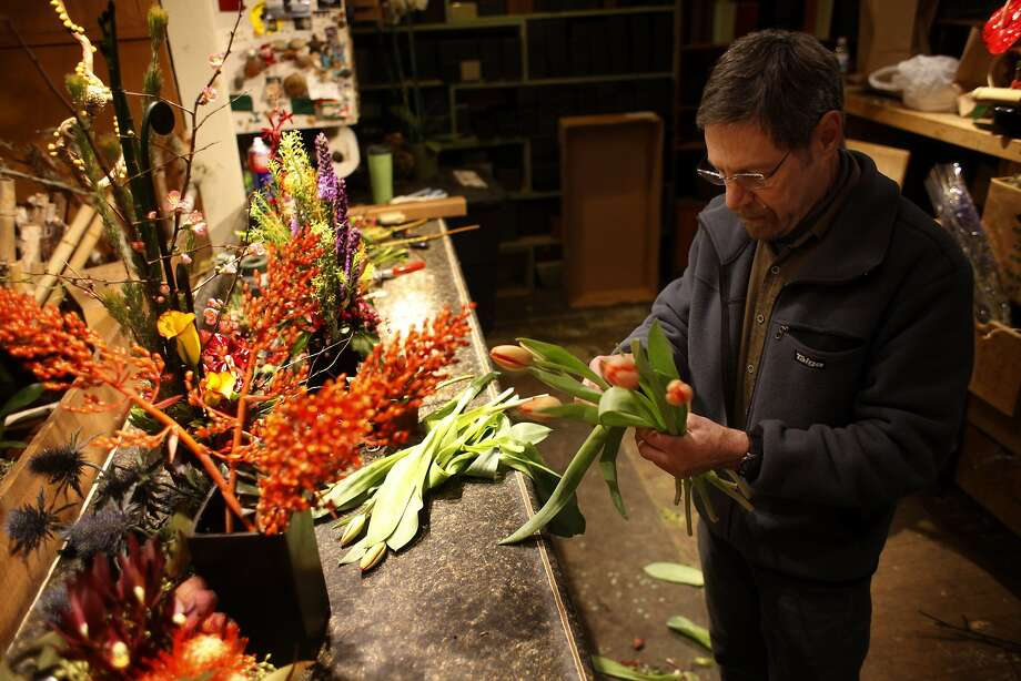 "Ixia founder and owner Gary Weiss, who named his shop after a tiny South African bulb, is known for adding a ""tweak"" to floral creations. Photo: Lacy Atkins, The Chronicle"