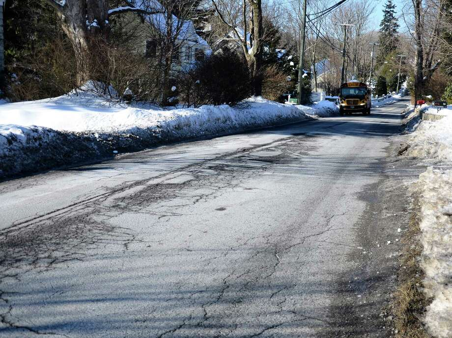 A school bus is seen on Old Norwalk Road in New Canaan on Tuesday, Feb. 11. The Board of Selectmen approved this week a contract to design a sidewalk in this area, which runs between the Kiwanis Park and the bridge next to Main Street. Photo: Nelson Oliveira / New Canaan News