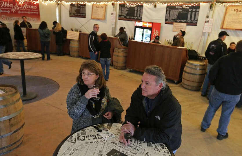 Tina (left) and John Vroman enjoy wine in the wine garden during the San Antonio Stock Show & Rodeo