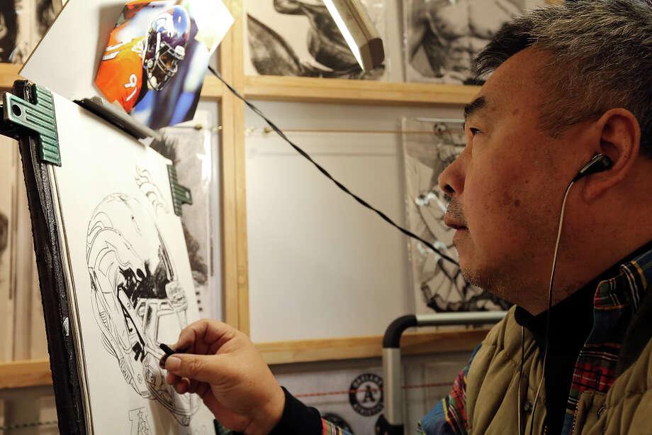 Charcoal artist Alen Ma works on a piece during the San Antonio Stock Show & Rodeo Monday Feb. 10, 2014. Photo: Edward A. Ornelas, San Antonio Express-News / © 2014 San Antonio Express-News