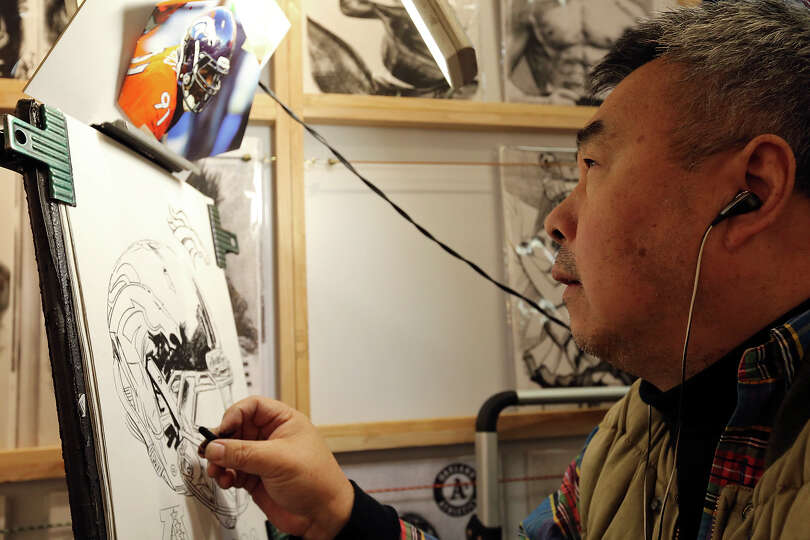Charcoal artist Alen Ma works on a piece during the San Antonio Stock Show & Rodeo Monday Feb. 10, 2