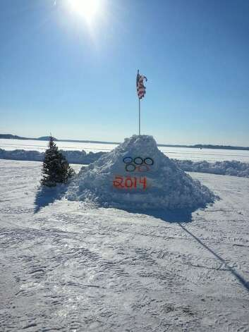 Gary Bazar, who lives at Saratoga Lake, gets into the Winter Olympics spirit with this monument ? alas, not permanent ? on the north end of the lake. (Tina Trifaro)