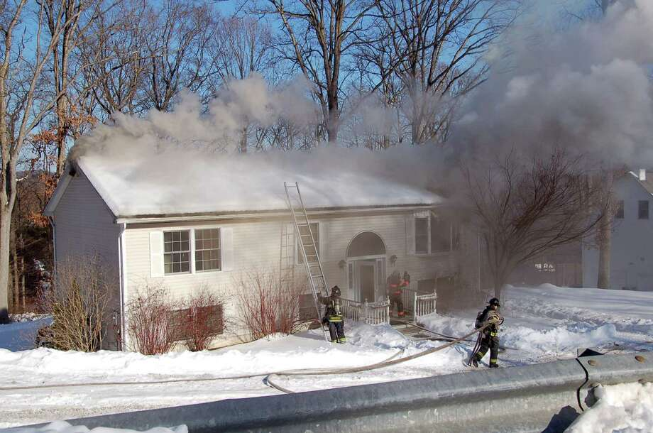 A house fire on 2 Sylvan Road in Danbury, Conn caused heavy damage. No injuries were reported, Tuesday afternoon, Feb. 11, 2014. Photo: Contributed Photo/ Mark Omasta, Contributed Photo / The News-Times Contributed