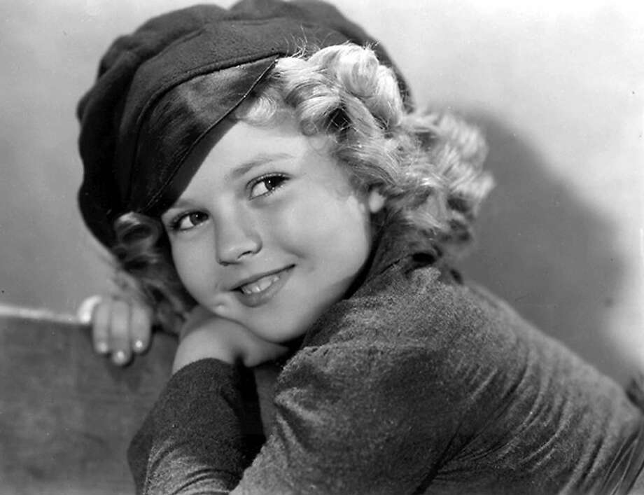 "(FILES) This undated photo show US child film star Shirley Temple. Hollywood star Shirley Temple has died at the age of 85, US media has announced on February 11, 2014. During 1934-38, the actress appeared in more than 20 feature films and was consistantly the top US movie star. Shirley Temple Black was US Ambassador to Ghana and to Czechoslovakia. AFP PHOTO HO RESTRICTED TO EDITORIAL USE - MANDATORY CREDIT ""AFP PHOTO / HO"" - NO MARKETING NO ADVERTISING CAMPAIGNS - DISTRIBUTED AS A SERVICE TO CLIENTSHO/AFP/Getty Images Photo: Ho, AFP/Getty Images"