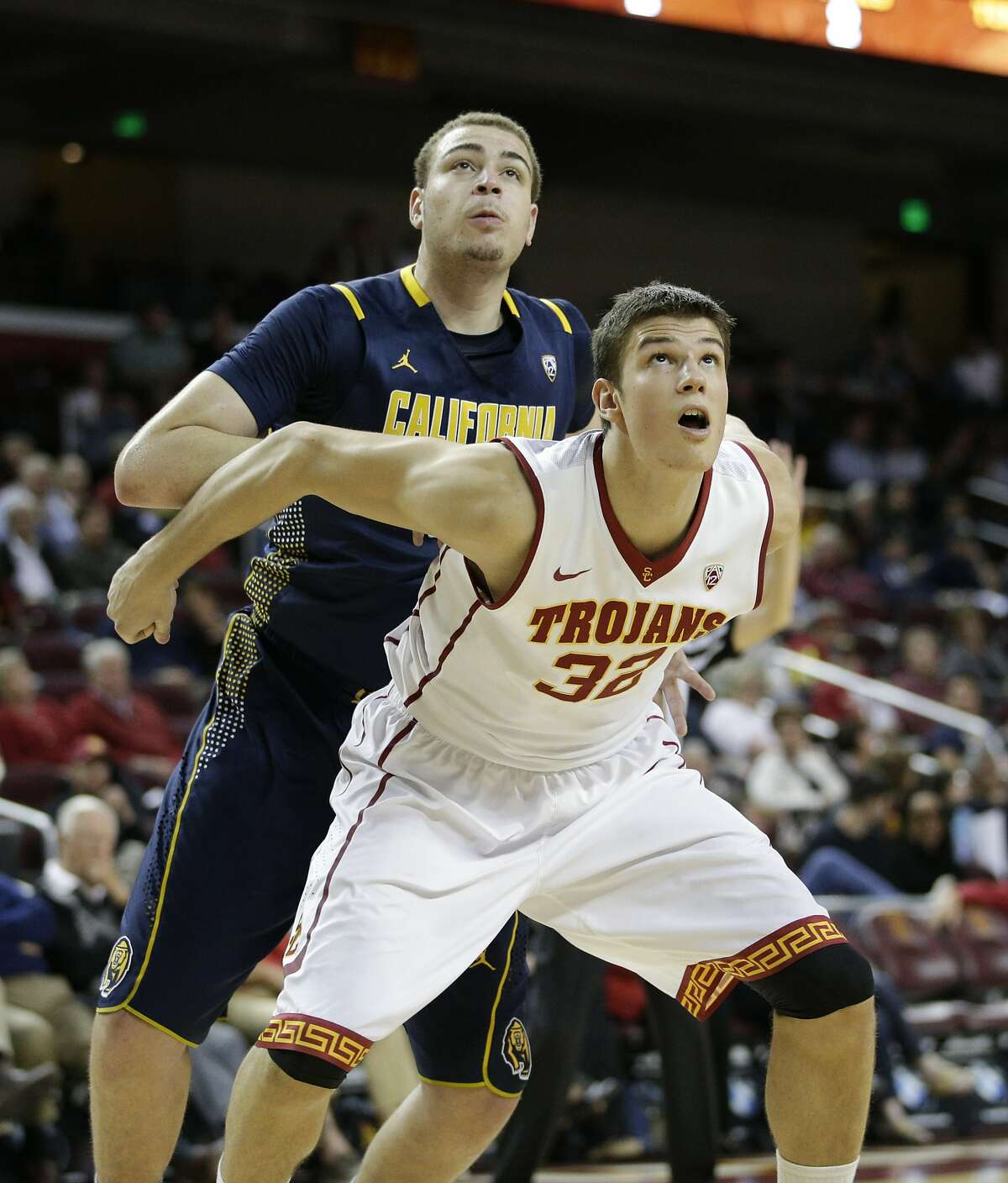Southern California 's Nikola Jovanovic, front, of Serbia, fights for position with California's Kameron Rooks during the first half of an NCAA college basketball game on Wednesday, Jan. 22, 2014, in Los Angeles. (AP Photo/Jae C. Hong)