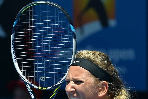 Belarus's Victoria Azarenka shouts during her women's singles match against Poland's Agnieszka Radwanska on day ten of the 2014 Australian Open tennis tournament in Melbourne on January 22, 2014.      IMAGE RESTRICTED TO EDITORIAL USE - STRICTLY NO COMMERCIAL USE         AFP PHOTO / PAUL CROCKPAUL CROCK/AFP/Getty Images