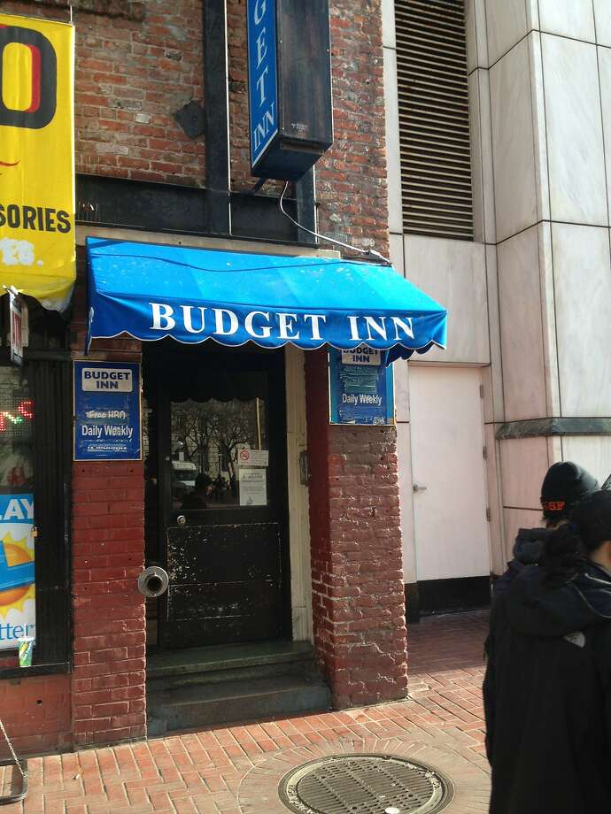 S.F. police officers paid out of their own pockets so a homeless family could spend a night out of the rain at the Budget Inn on Market Street. Photo: Phil Matier/San Francisco Chroni