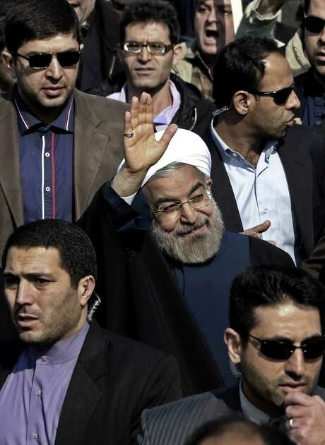 """Iranian President Hassan Rouhani said nuclear talks with world powers must be """"based on good intentions and peacefulness."""" He spoke to hundreds of thousands in Tehran marking the 35th anniversary of the Islamic revolution. Photo: Vahid Salemi / Associated Press / AP"""