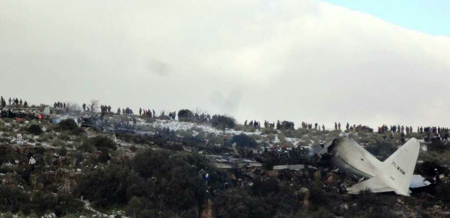 Civil defense officials said the U.S.-built C-130 Hercules Algerian military transport plane that crashed into Mount Fortas in eastern Algeria in bad weather broke into three parts. Photo: Mohamed Ali / Associated Press / AP