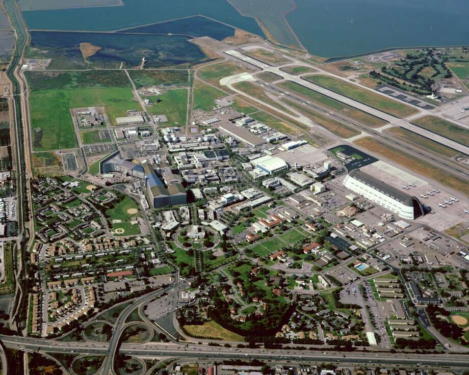 An aerial view of NASA Ames in Mountain View. For its most recent deal on Moffett Field, Google has agreed to renovate the three hangars, including the landmark Hangar One. (NASA Ames) Photo: Handout, NASA Ames