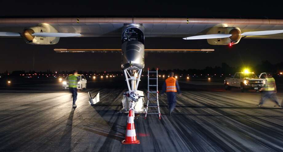 Members of the ground crew prepare the Solar Impulse for flight on May 3, 2013. The solar-powered experimental plane took off just before sunrise on a multi-city cross-country tour. (Paul Chinn/San Francisco Chronicle) Photo: Paul Chinn, The Chronicle